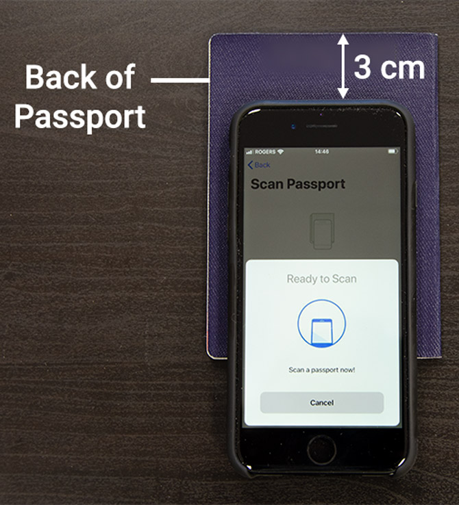 Place your passport face down on the table with the back cover facing upwards. Place your phone (screen up) over the back cover of your passport, about 3 cm below the top of your passport.